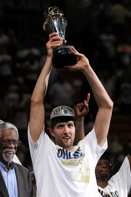 MIAMI, FL - JUNE 12:  Dirk Nowitzki #41 of the Dallas Mavericks holds up the Bill Russell Finals MVP trophy after Bill Russell presented it to him following the Mavericks 105-95 win against the Miami Heat in Game Six of the 2011 NBA Finals at American Air