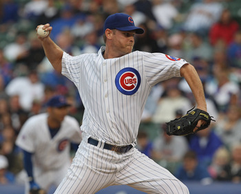 CHICAGO, IL - MAY 29: Kerry Wood #34 of the Chicago Cubs delivers the ball against the Pittsburgh Pirates at Wrigley Field on May 29, 2011 in Chicago, Illinois. The Cubs defeated the Pirates 3-2.  (Photo by Jonathan Daniel/Getty Images)