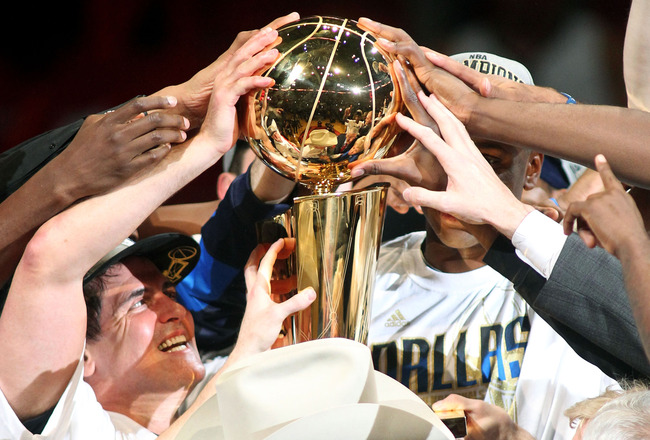MIAMI, FL - JUNE 12:  Team owner Mark Cuban of the Dallas Mavericks celebrates with the Larry O'Brien trophy after the Mavericks won 105-95 against the Miami Heat in Game Six of the 2011 NBA Finals at American Airlines Arena on June 12, 2011 in Miami, Flo