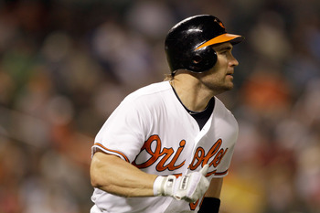 BALTIMORE, MD - JUNE 07:  Luke Scott #30 of the Baltimore Orioles follows his seventh inning doiuble against the Oakland Athletics at Oriole Park at Camden Yards on June 7, 2011 in Baltimore, Maryland. The Baltimore Orioles defeated the Oakland Athletics