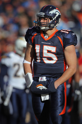 DENVER - JANUARY 02:  Quarterback Tim Tebow #15 of the Denver Broncos looks on against the San Diego Chargers at INVESCO Field at Mile High on January 2, 2011 in Denver, Colorado.  (Photo by Doug Pensinger/Getty Images)