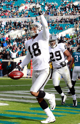 JACKSONVILLE, FL - DECEMBER 12:  Louis Murphy #18 of the Oakland Raiders celebrates a touchdown during the game against the Jacksonville Jaguars at EverBank Field on December 12, 2010 in Jacksonville, Florida.  (Photo by Sam Greenwood/Getty Images)