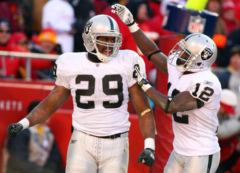 KANSAS CITY, MO - JANUARY 02:  Running back Michael Bush #29 of the Oakland Raiders is congratulated by wide receiver Jacoby Ford #12 after scoring a touchdown in a game against the Kansas City Chiefs at Arrowhead Stadium on January 2, 2011 in Kansas City