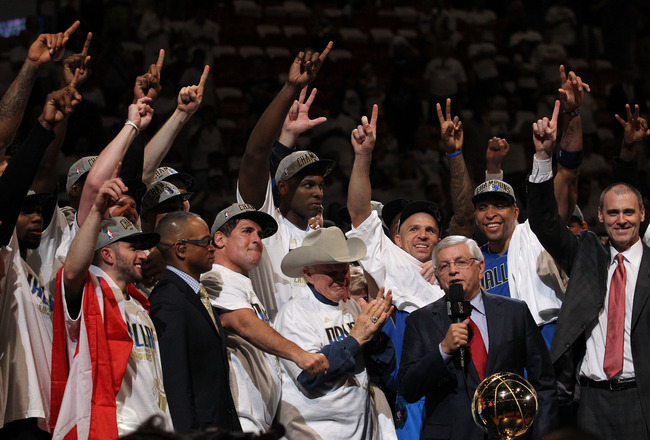 MIAMI, FL - JUNE 12:  NBA Commissioner David Stern presents the Larry O'Brien trophy to the Dallas Mavericks founder Don J. Carter next to team owner Mark Cuban after the Mavericks won 105-95 against the Miami Heat in Game Six of the 2011 NBA Finals at Am