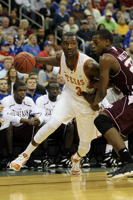 KANSAS CITY, MO - MARCH 11:  Jordan Hamilton #3 of the Texas Longhorns drives with the ball against Khris Middleton #22 of the Texas A&M Aggies during their semifinal game in the 2011 Phillips 66 Big 12 Men's Basketball Tournament at Sprint Center on Marc