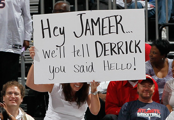 ATLANTA, GA - APRIL 28:  A fan of the Atlanta Hawks holds up a sign against the Orlando Magic during Game Six of the Eastern Conference Quarterfinals in the 2011 NBA Playoffs at Philips Arena on April 28, 2011 in Atlanta, Georgia.  NOTE TO USER: User expr