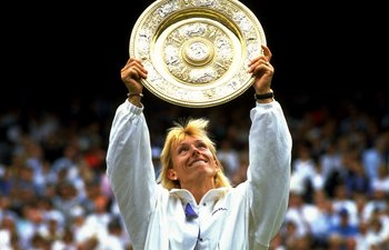 Jul 1990:  Martina Navratilova of the USA holds up the winners'' plate after winning the Wimbledon Championships played at Wimbledon, London, England.  \ Mandatory Credit: Allsport UK /Allsport