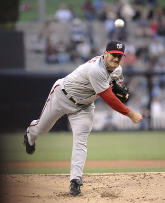 SAN DIEGO, CA - JUNE 10: Jason Marquis #21 of the Washington Nationals pitches during the first inning of a baseball game against the San Diego Padres at Petco Park on June 10, 2011 in San Diego, California.  (Photo by Denis Poroy/Getty Images)