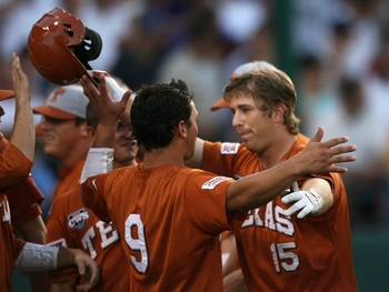 OMAHA, NE - JUNE 23:  (R-L) Russell Moldenhauer #15 of the Texas Longhorns celebrates with teammate Kris Connor #9 after Moldenhauer hit a third inning homerun against the Louisiana State University Tigers during Game 2 of the 2009 NCAA College World Seri