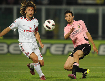 PALERMO, ITALY - MAY 10:  Javier Pastore (R) of Palermo and Andrea Pirlo of Palermo compete for the ball during the Tim Cup between US Citta di Palermo and AC Milan at Stadio Renzo Barbera on May 10, 2011 in Palermo, Italy.  (Photo by Tullio M. Puglia/Get