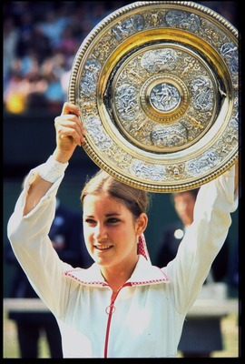 JUL 1974:  CHRIS EVERT OF THE UNITED STATES HOLDS THE LADIES SINGLES PLATE ALOFT AFTER WINNING ON THE CENTRE COURT AT WIMBLEDON.