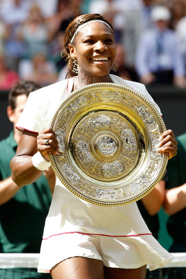 LONDON, ENGLAND - JULY 03:  Serena Williams of USA lifts the Championship trophy after winning her Ladies Singles Final Match against Vera Zvonareva of Russia on Day Twelve of the Wimbledon Lawn Tennis Championships at the All England Lawn Tennis and Croq