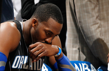 ATLANTA, GA - APRIL 28:  Dwight Howard #12 of the Orlando Magic sits on the bench during a timeout before the final seconds against the Atlanta Hawks during Game Six of the Eastern Conference Quarterfinals in the 2011 NBA Playoffs at Philips Arena on Apri