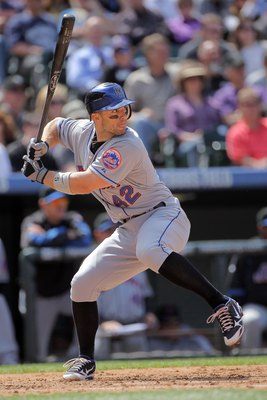 DENVER - APRIL 15:  Third baseman David Wright #42 of the New York Mets takes an at bat against the Colorado Rockies at Coors Field on April 15, 2010 in Denver, Colorado. All the players in MLB wore #42 today in honor of Jackie Robinson Day. The Mets defe
