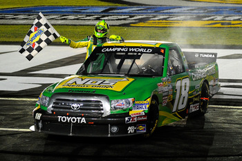 CHARLOTTE, NC - MAY 20:  Kyle Busch, driver of the #18 NOS Energy Drink Toyota, celebrates with the checkered flag after winning the NASCAR Camping World Truck Series North Carolina Education Lottery 200 at Charlotte Motor Speedway on May 20, 2011 in Char
