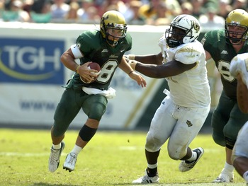 TAMPA, FL - OCTOBER 13:  Quarterback Matt Grothe #8 of the University of South Florida Bulls rushes upfield against the University of Central Florida Knights on October 13, 2007 at Raymond James Stadium in Tampa, Florida. (Photo by Al Messerschmidt/Getty