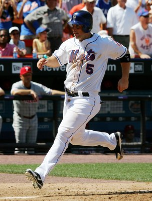 NEW YORK - AUGUST 05:  David Wright #5 of the New York Mets scores his teams fourth run against the Philadelphia Phillies in the sixth inning on August 5, 2006 at Shea Stadium in the Flushing neighborhood of the Queens borough of New York City. The Mets d