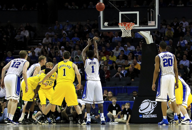 CHARLOTTE, NC - MARCH 20:  Kyrie Irving #1 of the Duke Blue Devils shoots a free throw while taking on the Michigan Wolverines during the third round of the 2011 NCAA men's basketball tournament at Time Warner Cable Arena on March 20, 2011 in Charlotte, N