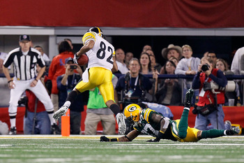 ARLINGTON, TX - FEBRUARY 06:  Antwaan Randle El #82 of the Pittsburgh Steelers scores a 2-point conversion in the fourth quarter against Sam Shields #37 of the Green Bay Packers  during Super Bowl XLV at Cowboys Stadium on February 6, 2011 in Arlington, T
