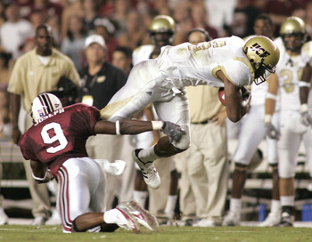 COLUMBIA, SC - SEPTEMBER 1:  Jonathan Joseph #9 of the South Carolina Gamecocks trips Brandon Marshall #9 of the University of Central Florida Golden Knights during a game on September 1, 2005 at Williams-Brice Stadium in Columbia, South Carolina.  (Photo