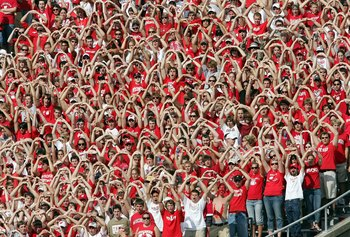 MADISON, WI - SEPTEMBER 16:  The Wisconsin Badgers student section helps their team during the opening kickoff against the San Diego State Aztecs on September 16, 2006 at Camp Randall Stadium in Madison, Wisconsin.  (Photo by Elsa/Getty Images)