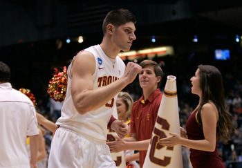 DAYTON, OH - MARCH 16: Nikola Vucevic #5 of the USC Trojans runs onto the court as he is introduced before the game against the Virginia Commonwealth Rams during the first round of the 2011 NCAA men's basketball tournament at UD Arena on March 16, 2011 in