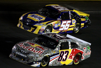 CONCORD, NC - MAY 29:  Brian Vickers, driver of the #83 Red Bull Toyota, races side by side with Martin Truex Jr., driver of the #56 NAPA Auto Parts Toyota, during the NASCAR Sprint Cup Series Coca-Cola 600 at Charlotte Motor Speedway on May 29, 2011 in C