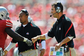 COLUMBUS, OH - SEPTEMBER 18:  Assistant Coach Luke Fickell of the Ohio State Buckeyes fists pump one of his players during a game against the Ohio Bobcats at Ohio Stadium on September 18, 2010 in Columbus, Ohio.  (Photo by Jamie Sabau/Getty Images)