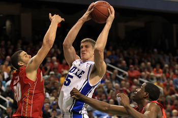 GREENSBORO, NC - MARCH 11:  Mason Plumlee #5 of the Duke Blue Devils shoots against Jordan Williams #20 and Dino Gregory #33 of the Maryland Terrapins during the second half in the quarterfinals of the 2011 ACC men's basketball tournament at the Greensbor