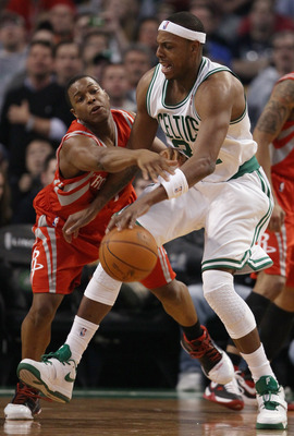 BOSTON, MA - JANUARY 10:  Paul Pierce #34 of the Boston Celtics tries to get around Kyle Lowry #7 of the Houston Rockets on January 10, 2011 at the TD Garden in Boston, Massachusetts.  The Rockets defeated the Celtics 108-102. NOTE TO USER: User expressly