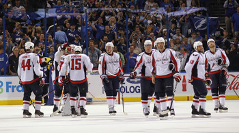 TAMPA, FL - MAY 04: The Washington Capitals line up to shake hands with the Tampa Bay Lightning following defeat in Game Four of the Eastern Conference Semifinals during the 2011 NHL Stanley Cup Playoffs at the St Pete Times Forum on May 4, 2011 in Tampa,