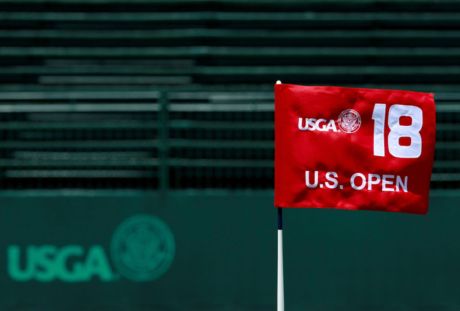 BETHESDA, MD - JUNE 13:  The flag on the 18th hole blows in the breeze during a practice round prior to the start of the 111th U.S. Open at Congressional Country Club on June 13, 2011 in Bethesda, Maryland.  (Photo by Scott Halleran/Getty Images)