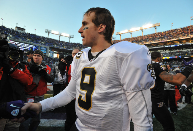 BALTIMORE, MD - DECEMBER 19:  Drew Brees #9 of the New Orleans Saints walks off the field after the game against the Baltimore Ravens  at M&T Bank Stadium on December 19, 2010 in Baltimore, Maryland. The Ravens defeated the Saints 30-24. (Photo by Larry F
