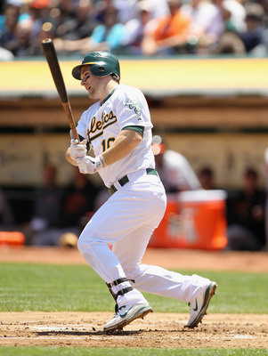 OAKLAND, CA - MAY 29:  Josh Willingham #16 of the Oakland Athletics hits a single to score Daric Barton #10 in the first inning against the Baltimore Orioles at Oakland-Alameda County Coliseum on May 29, 2011 in Oakland, California.  (Photo by Ezra Shaw/G