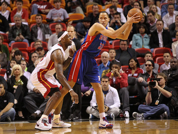 MIAMI, FL - JANUARY 28:  Tayshaun Prince #22 of of the Detroit Pistons posts up LeBron James #6 of the Miami Heat during a game at American Airlines Arena on January 28, 2011 in Miami, Florida. NOTE TO USER: User expressly acknowledges and agrees that, by