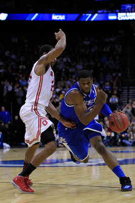NEWARK, NJ - MARCH 25:  Terrence Jones #3 of the Kentucky Wildcats drives to the basket against David Lighty #23 of the Ohio State Buckeyes during the first half of the east regional semifinal of the 2011 NCAA Men's Basketball Tournament at the Prudential