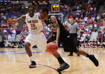 TUCSON, AZ - MARCH 19:  Ramone Moore #23 of the Temple Owls drives past Kawhi Leonard #15 of the San Diego State Aztecs during the third round of the 2011 NCAA men's basketball tournament at McKale Center on March 19, 2011 in Tucson, Arizona.  (Photo by H