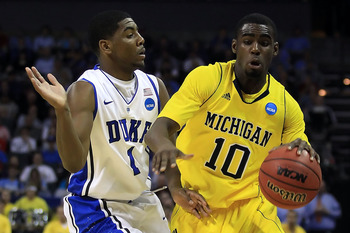 CHARLOTTE, NC - MARCH 20:  Tim Hardaway Jr. #10 of the Michigan Wolverines drives on Kyrie Irving #1 of the Duke Blue Devils in the first half during the third round of the 2011 NCAA men's basketball tournament at Time Warner Cable Arena on March 20, 2011