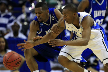 CHARLOTTE, NC - MARCH 18:  Nolan Smith #2 of the Duke Blue Devils and Brandon Tunnell #5 of the Hampton Pirates battle for the ball in the first half during the second round of the 2011 NCAA men's basketball tournament at Time Warner Cable Arena on March