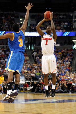 TAMPA, FL - MARCH 19:  Kenny Boynton #1 of the Florida Gators attempts a shot against Malcolm Lee #3 of the UCLA Bruins during the third round of the 2011 NCAA men's basketball tournament at St. Pete Times Forum on March 19, 2011 in Tampa, Florida. Florid