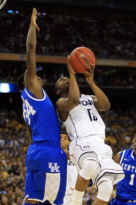 HOUSTON, TX - APRIL 02:  Kemba Walker #15 of the Connecticut Huskies goes up for a shoot against DeAndre Liggins #34 of the Kentucky Wildcats during the National Semifinal game of the 2011 NCAA Division I Men's Basketball Championship at Reliant Stadium o