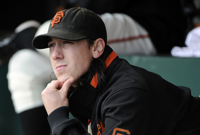SAN FRANCISCO, CA - JUNE 11: Tim Lincecum #55 of the San Francisco Giants sits in the dugout looking up at the score board after being taken out down 6 to 0 against the Cincinnati Reds in the fifth inning during a MLB baseball game June 11, 2011 at AT&amp;T P