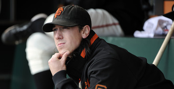 SAN FRANCISCO, CA - JUNE 11: Tim Lincecum #55 of the San Francisco Giants sits in the dugout looking up at the score board after being taken out down 6 to 0 against the Cincinnati Reds in the fifth inning during a MLB baseball game June 11, 2011 at AT&T P