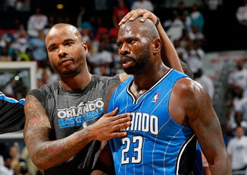 ATLANTA, GA - APRIL 22:  Jason Richardson #23 of the Orlando Magic walks off the court with Quentin Richardson #5 after being ejected for fighting with Zaza Pachulia #27 of the Atlanta Hawks during Game Three of the Eastern Conference Quarterfinals in the