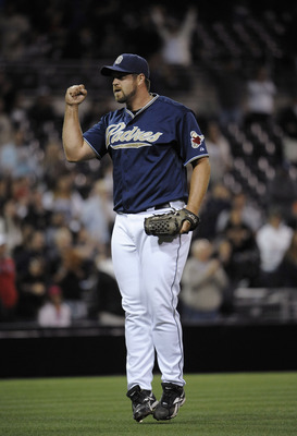 SAN DIEGO, CA - JUNE 4: Heath Bell #21 of the San Diego Padres pumps his fist after getting the last out in the ninth inning of a baseball game against the Houston Astros at Petco Park on June 4, 2011 in San Diego, California. The Padres won 6-3.  (Photo