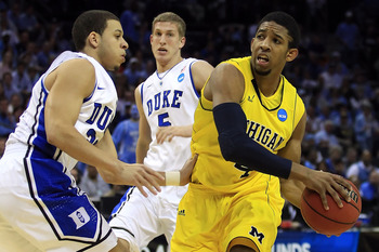 CHARLOTTE, NC - MARCH 20: Darius Morris #4 of the Michigan Wolverines drives on Seth Curry #30 of the Duke Blue Devils in the first half during the third round of the 2011 NCAA men's basketball tournament at Time Warner Cable Arena on March 20, 2011 in Ch