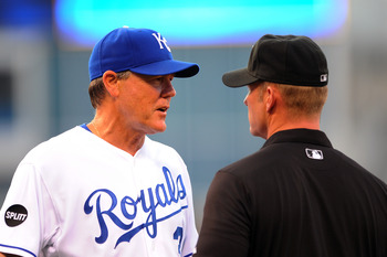 KANSAS CITY, MO - JUNE 6:  Manager Ned Yost #3 of the Kansas City Royals discusses a ruling with first base umpire Jim Wolf #28 after  Yunel Escobar of the Toronto Blue Jays was ruled safe at first base at Kauffman Stadium on June 6, 2011 in Kansas City,