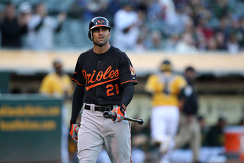OAKLAND, CA - MAY 27:  Nick Markakis #21 of the Baltimore Orioles reacts after striking out in the first inning against the Oakland Athletics during a Major League Baseball game at the Oakland-Alameda County Coliseum on May 27, 2011 in Oakland, California