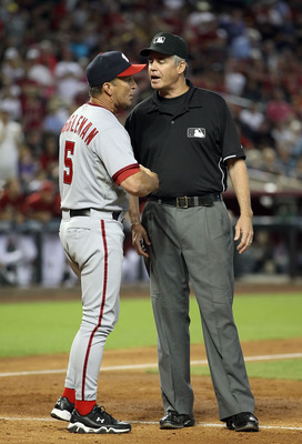 PHOENIX, AZ - JUNE 05:  Manager Jim Riggleman of the Washington Nationals argues with umpire Gary Darling during the Major League Baseball game against the Arizona Diamondbacks at Chase Field on June 5, 2011 in Phoenix, Arizona.  (Photo by Christian Peter