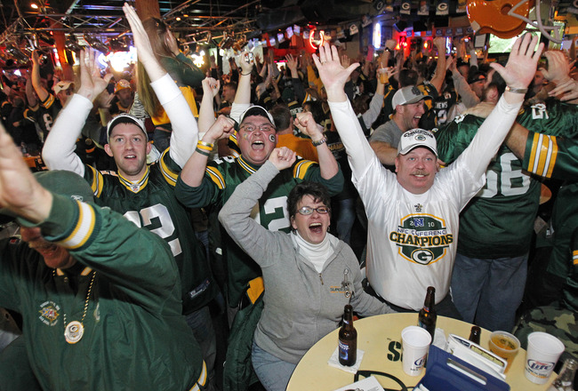 GREEN BAY, WI - FEBRUARY 06: Green Bay Packers fans react after watching the Green Bay Packers defeat the Pittsburgh Steelers in the Super Bowl at Stadium View Bar February 6, 2011 in Green Bay, Wisconsin.  (Photo by Matt Ludtke/Getty Images)